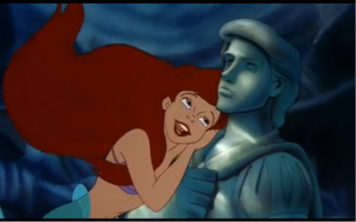 "Before transforming into a human, Ariel affectionately nestles a human statue that strikingly resembles Prince Eric. For Ariel, there is a noticeable lack in her life: as she sings in ""Part of Your World Reprise"", it becomes clear that what she misses is the ability to experience the human world, and discover human, heterosexual love. The love Ariel desires is a love that is ""not ordinary or mundane but, rather powerful, exceptional, and magical"" (Martin and Kazyak, 316). The kiss she must win before the third evening is her only means of securing her personal fulfillment, and Ariel demonstrates that her ""desire, choice, and empowerment are closely linked to catching and loving handsome men"" (Giroux, 71). Ariel's ""goals in the film seem limited to 'becoming part of (his) world,'"" and her solution to her dissatisfaction with underwater life comes through the form of marrying a man and leaving her troublesome situation behind completely, rather than rectifying the problem itself (Lacroix, 223 and Bell et al, 1995). The movie therefore suggests that marriage is an escape for other problems, and that the successful performance of gender can make this escape a feasible reality. Stressed heterosexuality as a solution to life's problems falls in conversation with Butler's idea of politically gendered bodies, and the idea that ""femininity is associated with desiring and attracting men (male erotic object choice), and masculinity [… as] desiring and attracting women (female erotic object choice)"" (McNeal, 350). Photo Credit: The Little Mermaid. Ron Clements and John Musker. Buena Vista Pictures Distribution, Inc, 1989. Screen capture at 00:34:58."