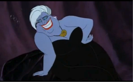 "Ursula's appearance is in all ways opposite from Ariel's, and therefore deviant from these norms. Her figure is overflowing and full, suggesting that she is overweight, with the absence of a distinct neck or set of elbows. Observing more bluntly, Mark Pinsky in The Gospel of Disney writes: ""she is fat and old, rarely a good combination for a woman in these stories"" (Pinsky, 140). In place of a slender, vibrantly green tail (signifying health and fertility), are a number of black, sucker-coated tentacles flailing in a disorderly manner. Ursula's face is laden with bright turquoise eye shadow contrasting sharply with her bright red lipstick. To complete her look, Ursula has very short white hair, suggesting an older ""lesbian"" style in juxtaposition with Ariel's luscious head of long red hair. Martin and Kazyak, researchers of heterosexual romantic love in G-rated films, note that ""Disney characters who do not fit into their societies echo the feeling of many gays and lesbians… many characters (especially villains) lend themselves to queer readings because of how they over-perform their gender roles"" (Martin and Kazyak, 320). In terms of her makeup (which is a caricature of conventional expectations of beauty), her revealing busty corset (which is implied to be repulsive due to her overweight appearance), and iconic mole as a beauty mark, Ursula certainly satisfies this criteria of ""overperforming"" the attractive ""female."" Photo Credit: Ibid. Screen capture at 00:43:26."